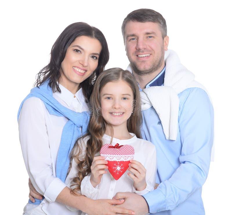 Gelukkige familie met een dochter op een witte achtergrond stock afbeelding