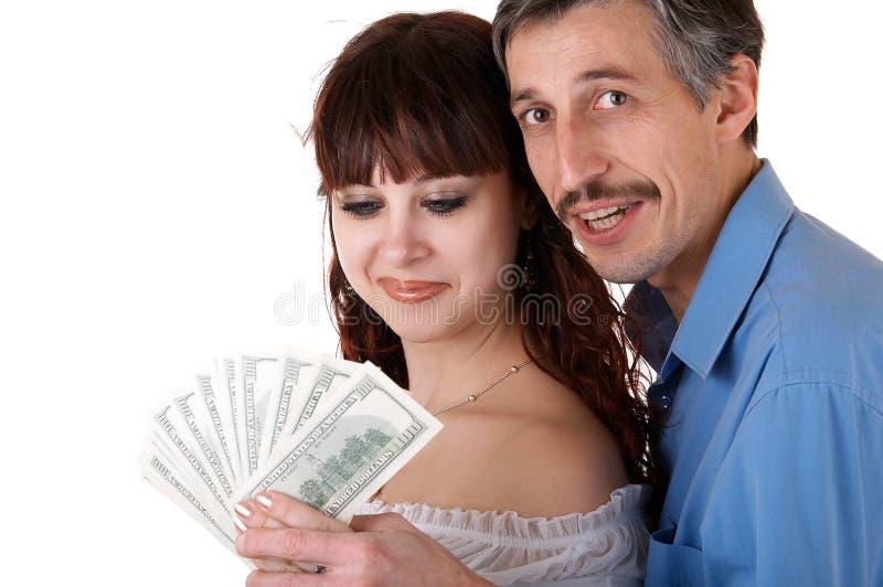 Gelukkige familie met geld royalty-vrije stock afbeelding