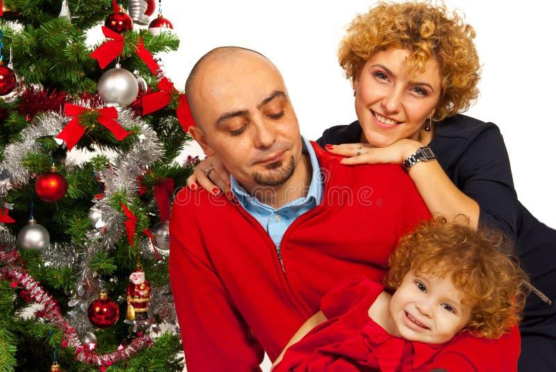 Gelukkige familie met Kerstboom stock foto