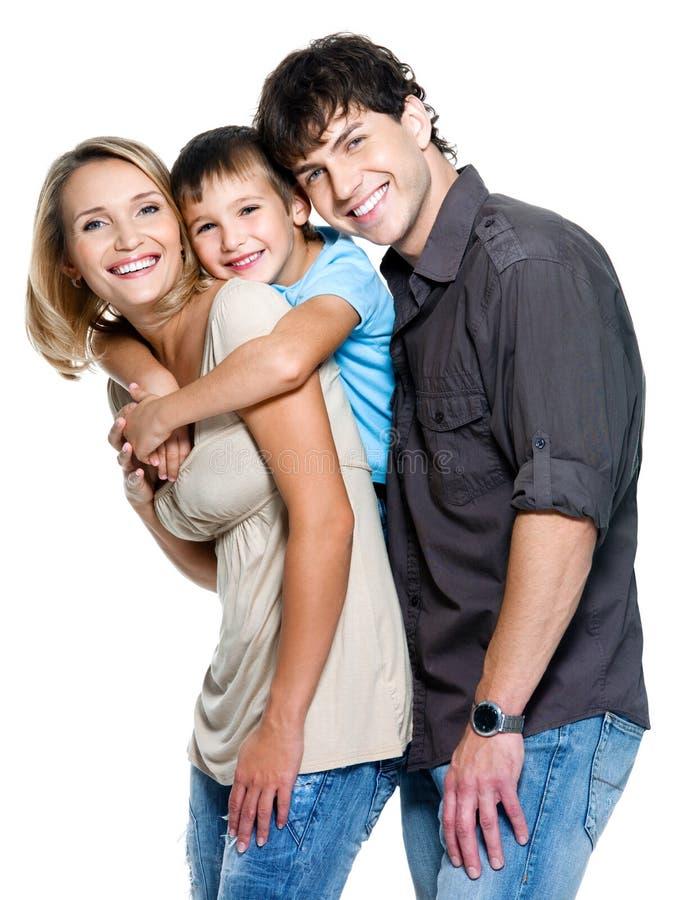 Gelukkige familie met kind stock afbeeldingen