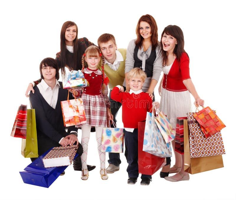 Gelukkige familie met kinderen en het winkelen zak. royalty-vrije stock foto