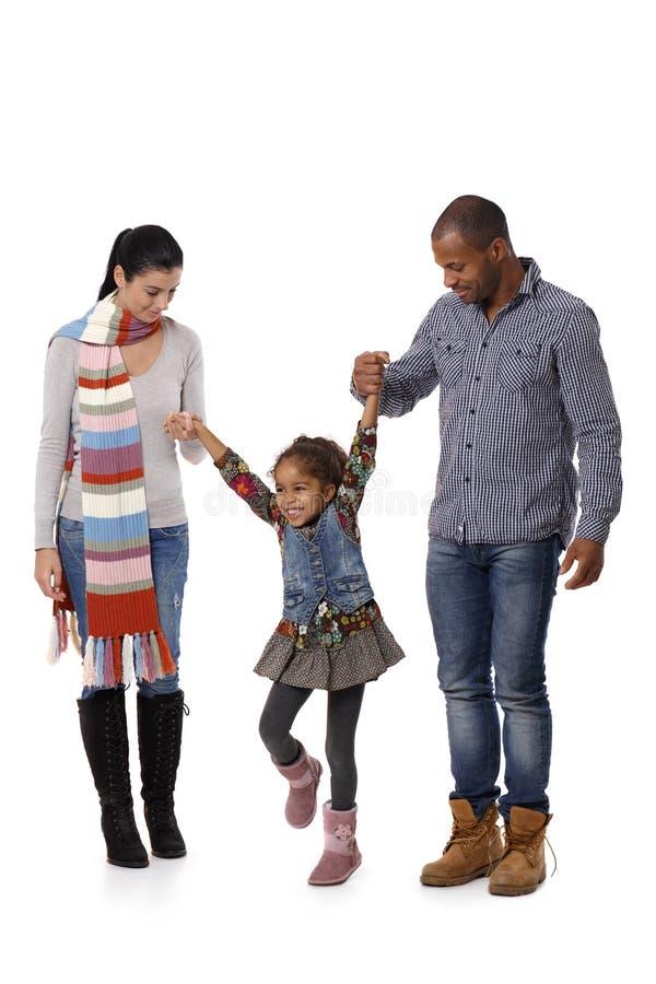 Gelukkige familie met meisje het lopen royalty-vrije stock afbeeldingen