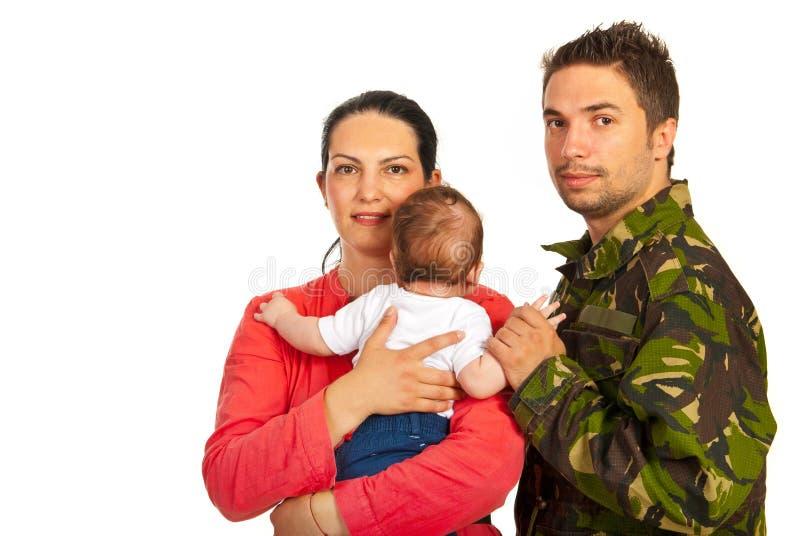 Gelukkige familie met militaire vader stock fotografie
