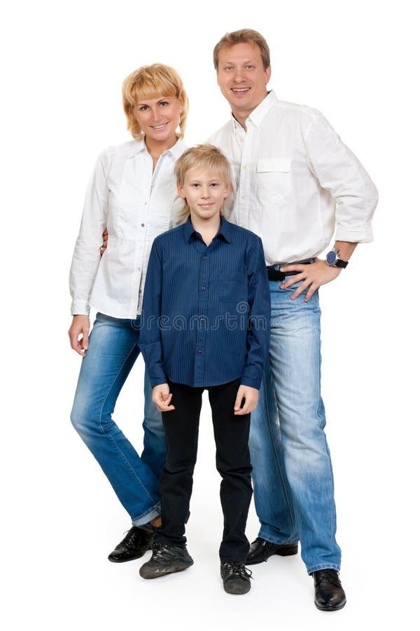 Gelukkige familie van drie mensen in de studio stock afbeelding