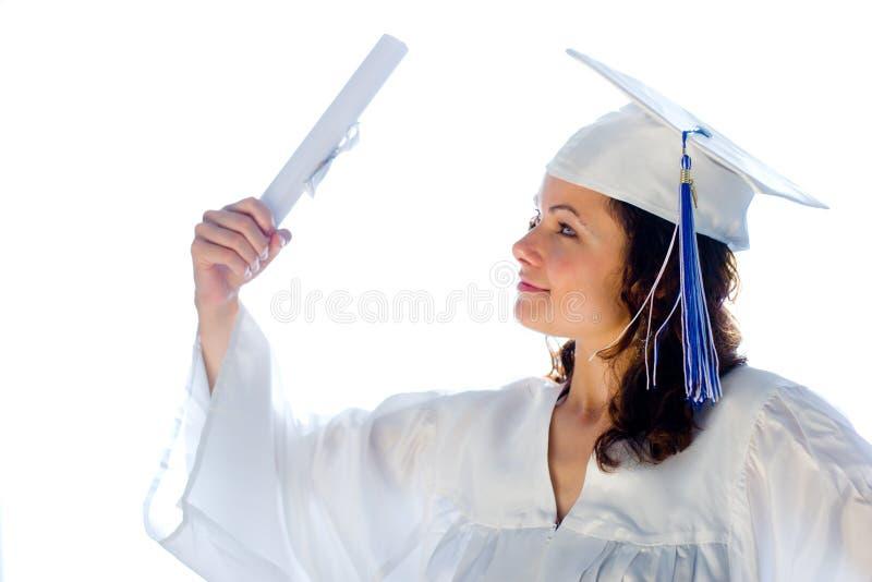 Gelukkige gediplomeerde met diploma stock afbeelding