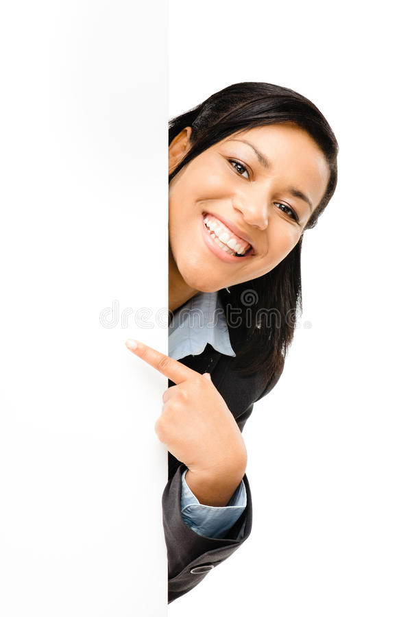Gelukkige gemengde ras bedrijfsvrouw die op leeg exemplaar ruimteiso richten royalty-vrije stock foto