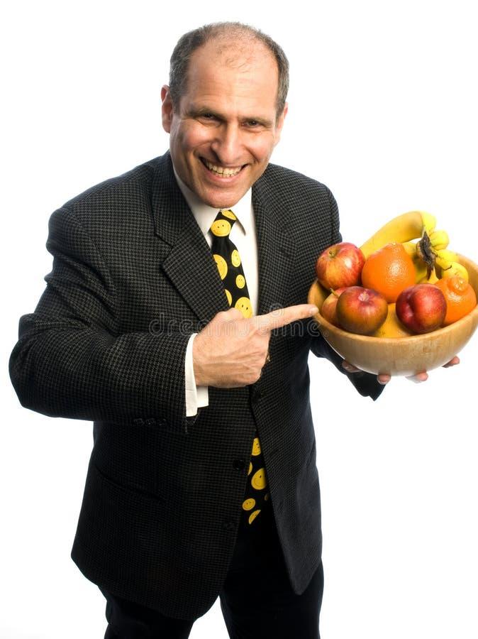 Gelukkige gezonde mens met kom fruit stock afbeelding
