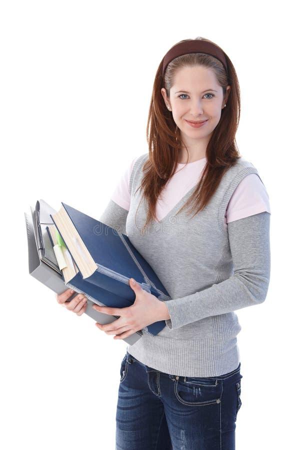 Gelukkige gingerishstudent met boeken stock afbeeldingen