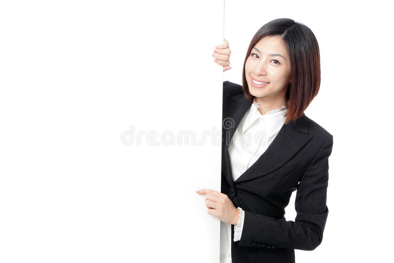 Gelukkige Glimlach die de bedrijfs van de Vrouw leeg aanplakbord toont royalty-vrije stock afbeeldingen