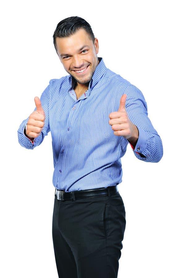 Gelukkige glimlachende jonge bedrijfsmens met duimen op gebaar stock foto