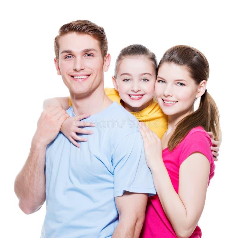 Gelukkige glimlachende jonge familie met meisje stock afbeeldingen