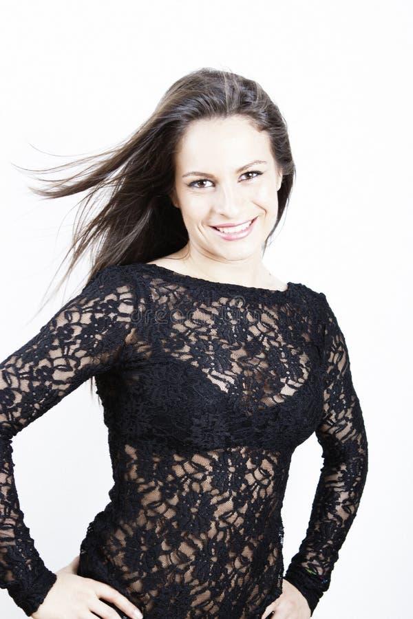 Gelukkige glimlachende jonge vrouw stock afbeeldingen