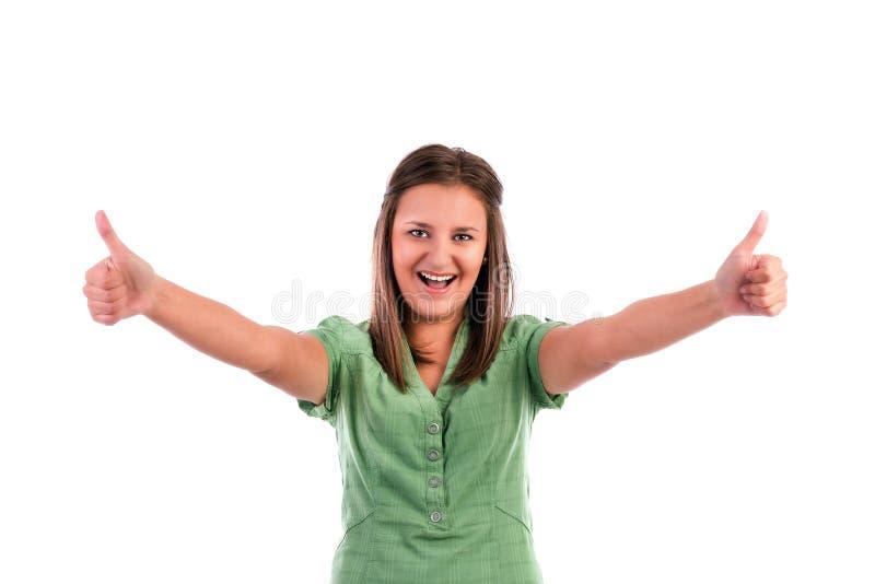 Gelukkige glimlachende jonge vrouw met duimen op gebaar royalty-vrije stock foto's
