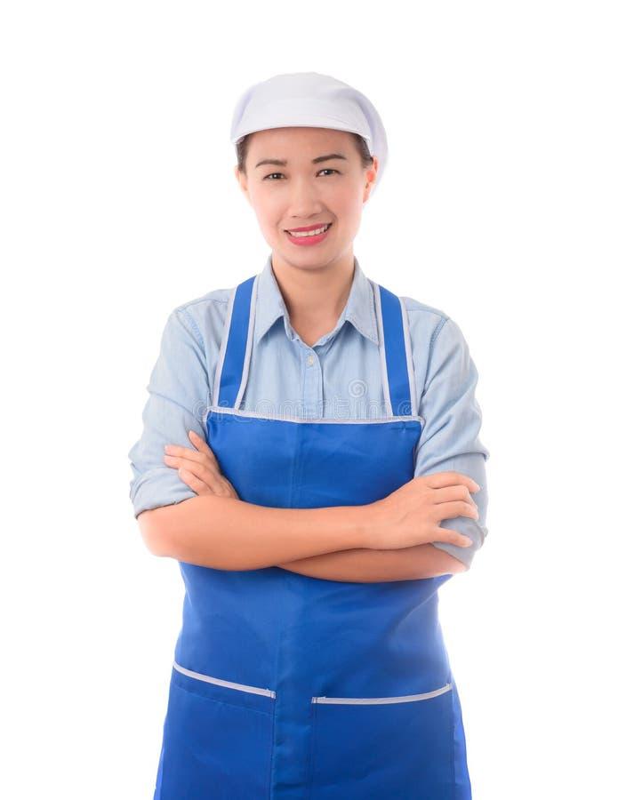 Gelukkige, glimlachende, positieve vrouwelijke chef-kok, Huisvrouw die, wapen Duitsland kruisen stock afbeeldingen