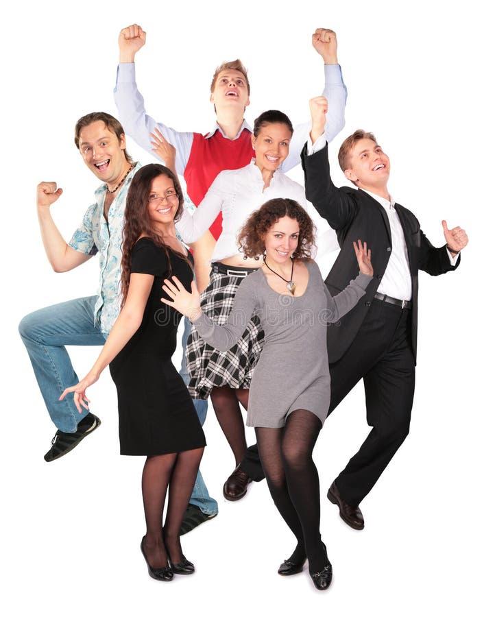 Gelukkige glimlachende springende groep stock fotografie