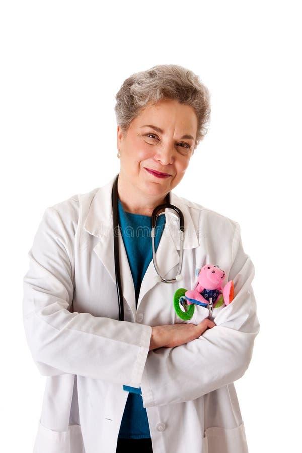 Gelukkige glimlachende vriendschappelijke pediater artsenverpleegster stock afbeelding