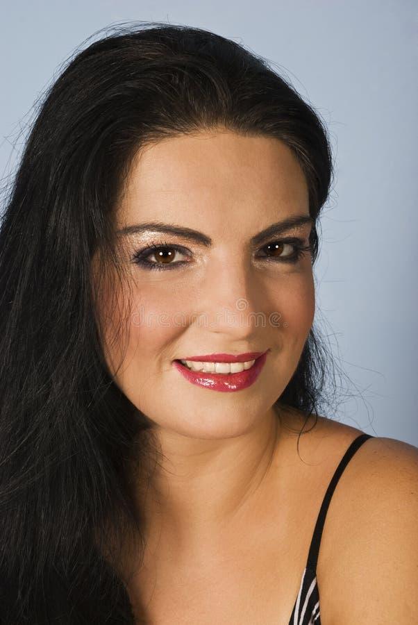Gelukkige glimlachende vrouw stock foto