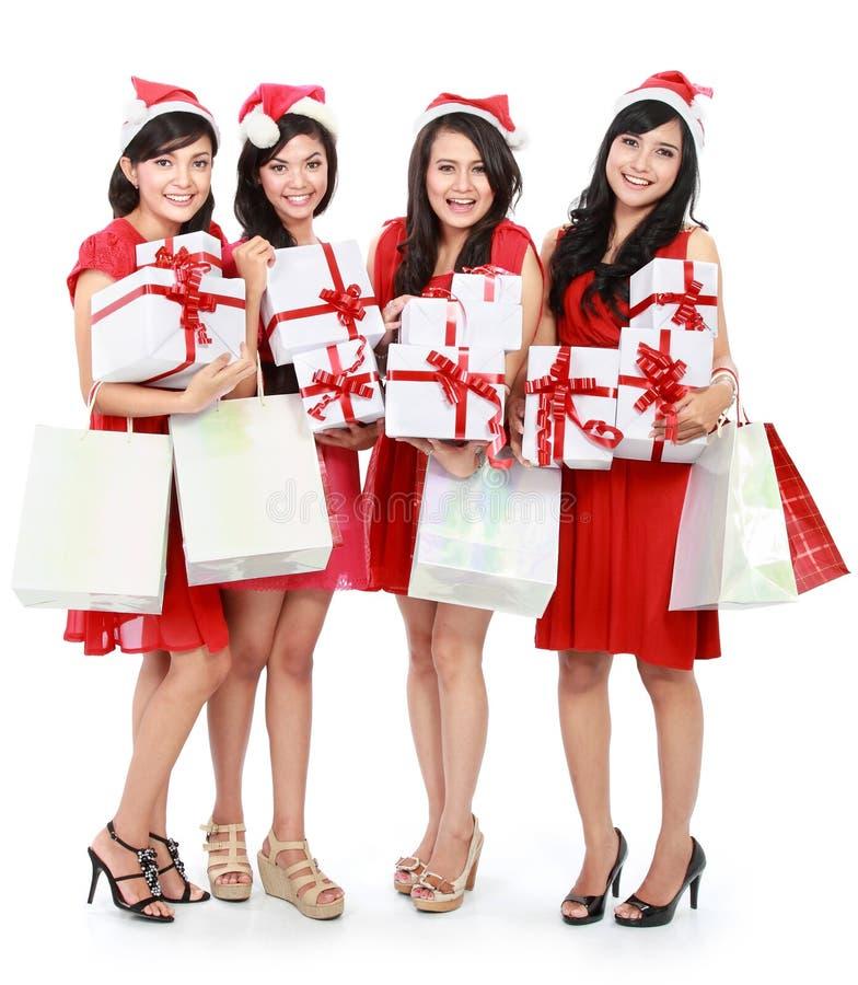 Gelukkige grappige mensen met van de de hoedenholding van Kerstmissanta de giftdozen a stock foto