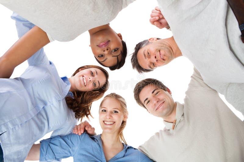 Gelukkige groep mensen stock afbeeldingen