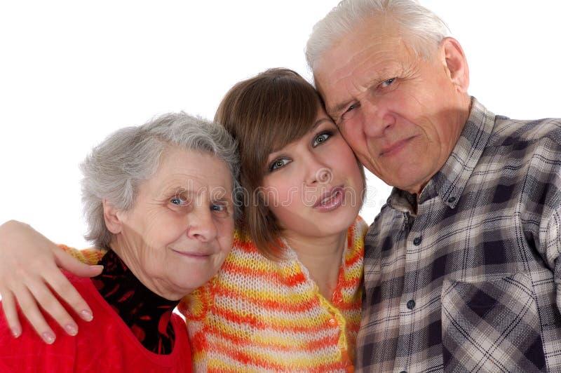Gelukkige grootouders en kleindochter die ca bekijken stock afbeelding
