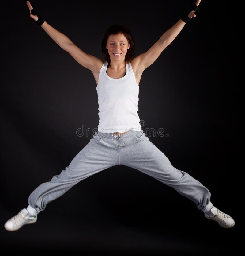 Gelukkige jonge atleet tijdens oefening royalty-vrije stock foto