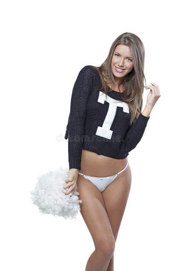 Gelukkige jonge die cheerleader met pom-pom op wit wordt geïsoleerd stock foto's