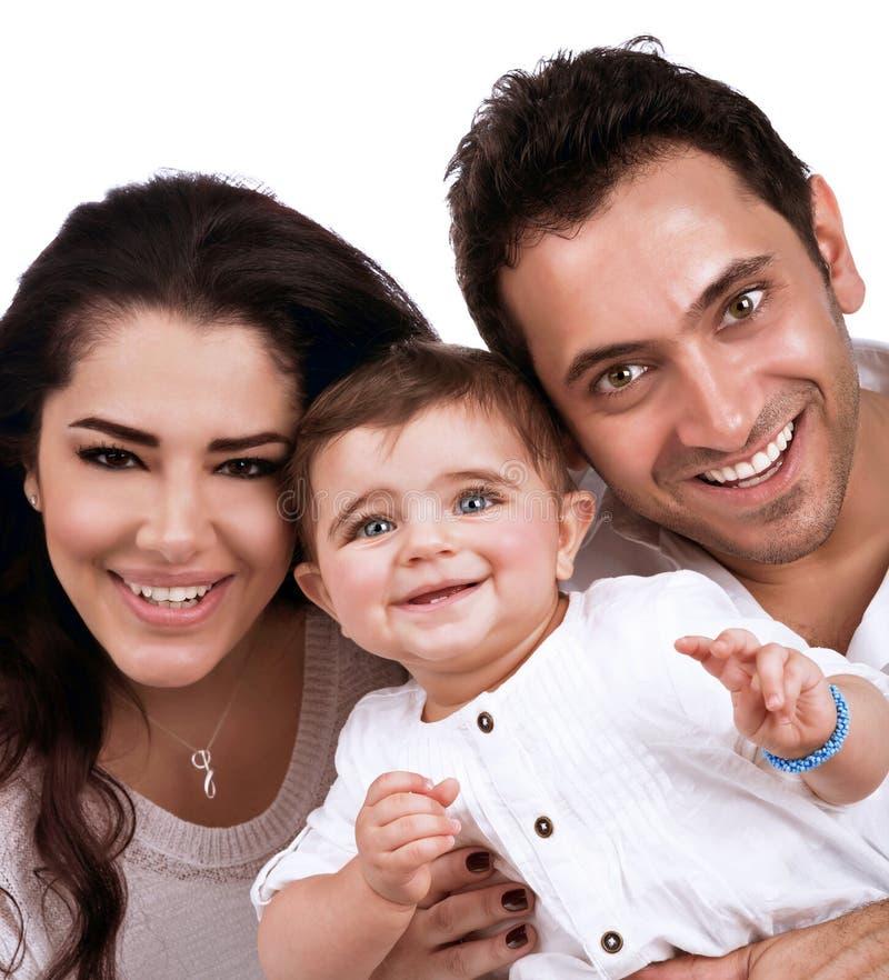 Gelukkige jonge familie stock fotografie