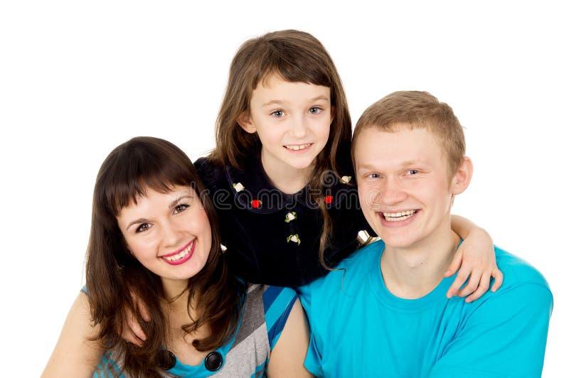 Gelukkige jonge familie met een kindmeisje stock foto