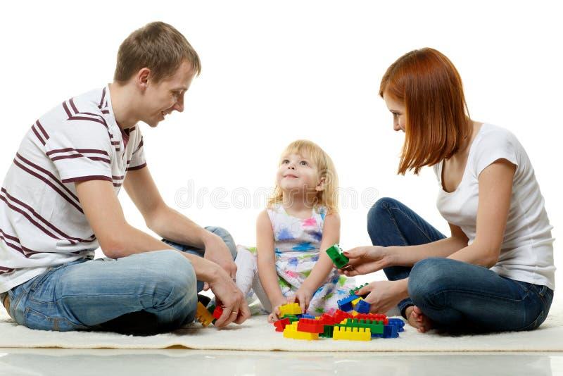Gelukkige jonge familie met kind. stock foto