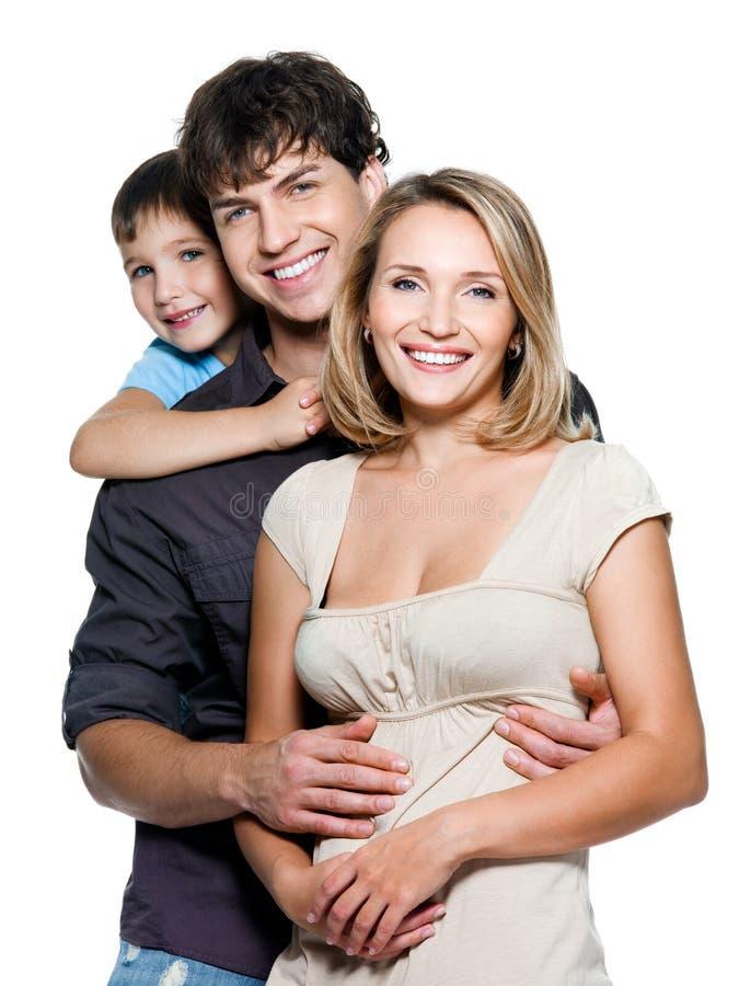 Gelukkige jonge familie met mooi kind stock afbeelding
