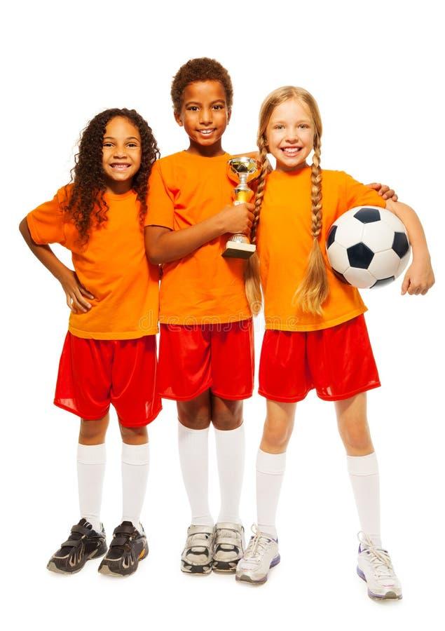 Gelukkige jonge geitjeswinnaars van voetbalspelen royalty-vrije stock afbeelding