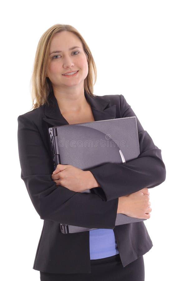 Gelukkige jonge laptop van de bedrijfsvrouwenholding royalty-vrije stock fotografie