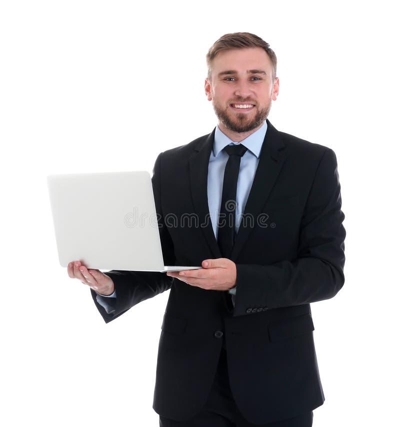 Gelukkige jonge laptop van de zakenmanholding op wit stock afbeeldingen