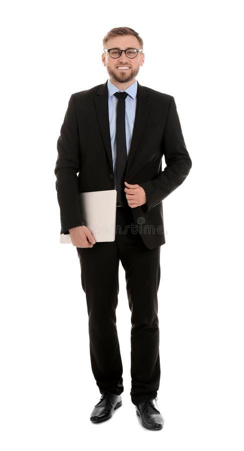 Gelukkige jonge laptop van de zakenmanholding op wit stock foto