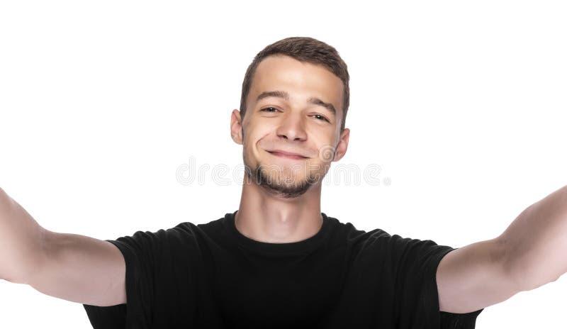 Gelukkige jonge mens die een selfiefoto nemen stock fotografie