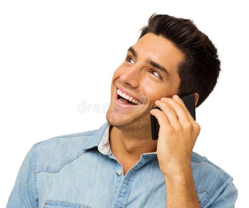 Gelukkige Jonge Mens die Slimme Telefoon met behulp van stock afbeeldingen
