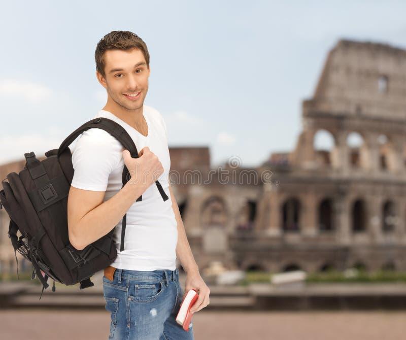 Gelukkige jonge mens met rugzak en boek het reizen royalty-vrije stock afbeeldingen