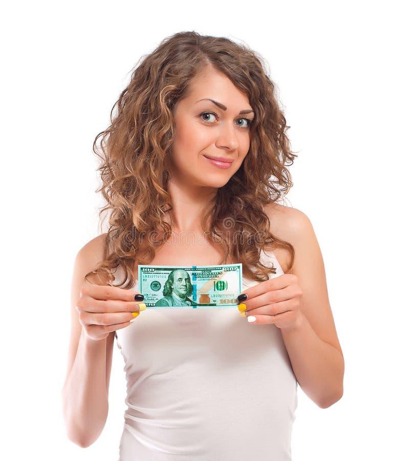Gelukkige jonge vrouw die honderd dollars steunt stock afbeeldingen