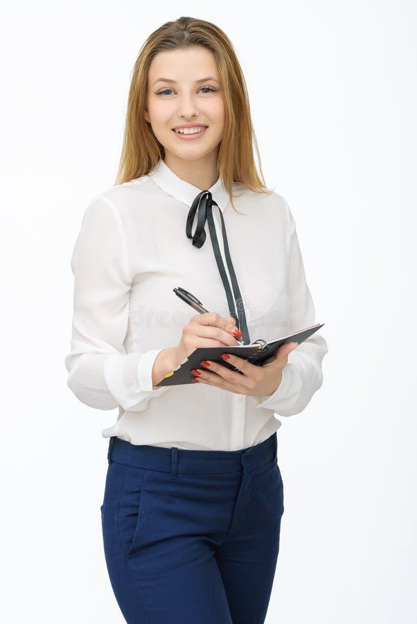 Gelukkige jonge vrouw die op witte achtergrond wordt geïsoleerd? stock foto's