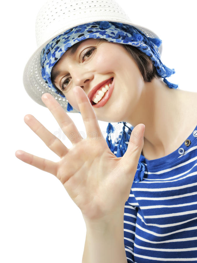 Gelukkige jonge vrouw in een de zomerhoed stock fotografie