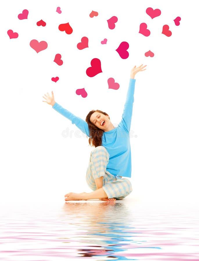 Gelukkige jonge vrouw met harten stock fotografie