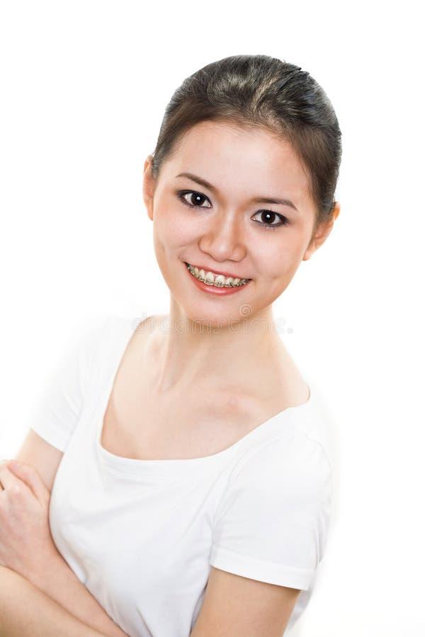 Gelukkige Jonge vrouw met steunen stock foto's