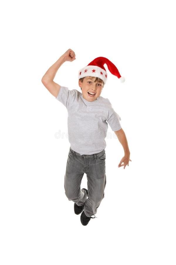 Gelukkige jongen in de hoed van de Kerstman stock foto