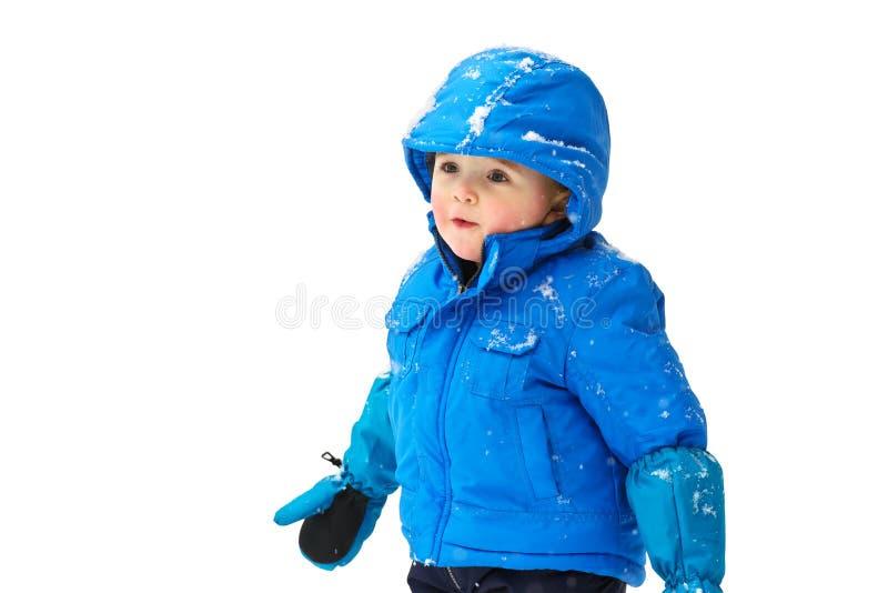 Gelukkige Jongen in een Geïsoleerde Snowsuit - royalty-vrije stock afbeeldingen