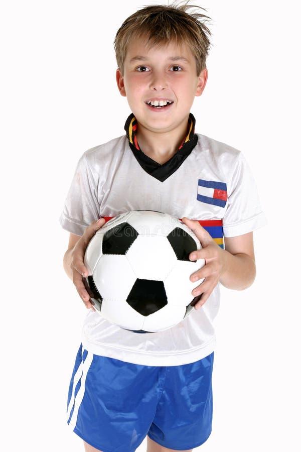 Gelukkige jongen met een voetbalbal stock foto's