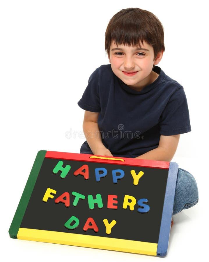 Gelukkige Jongen met het Gelukkige Teken van de Dag van Vaders royalty-vrije stock fotografie