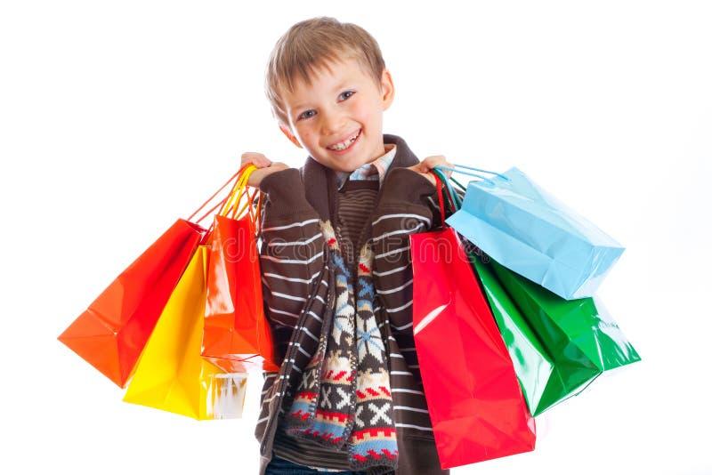 Gelukkige Jongen met het Winkelen Zakken royalty-vrije stock foto