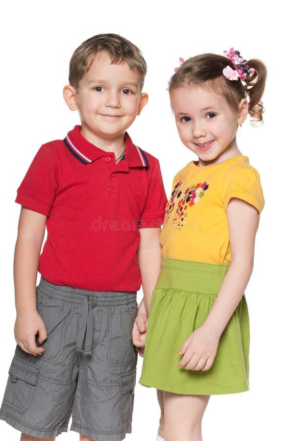 Gelukkige kinderen op de witte achtergrond royalty-vrije stock afbeeldingen