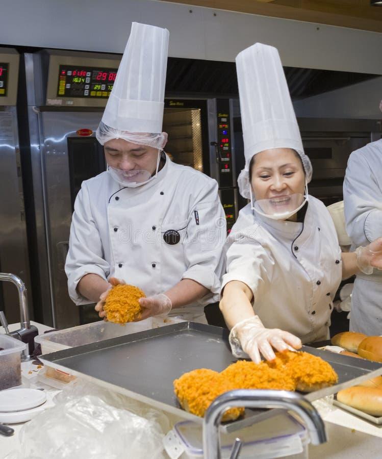 Gelukkige kooktoestellen royalty-vrije stock afbeelding