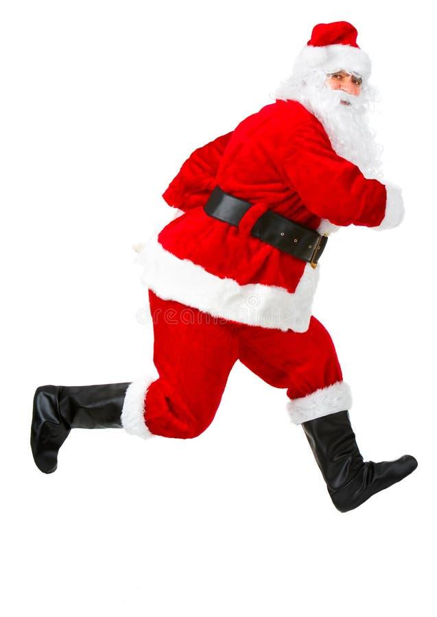 Gelukkige lopende Kerstmis Santas royalty-vrije stock foto's